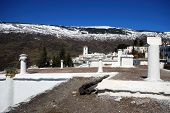 picture of snow capped mountains  - General view over town rooftops towards the snow capped mountains Bubion Las Alpujarras Granada Province Andalusia Spain Western Europe - JPG