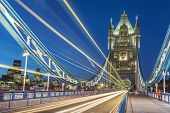 pic of london night  - Tower Bridge in London at night with moving red double - JPG