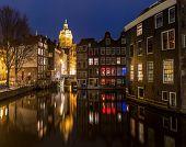 stock photo of nicholas  - Amsterdam Canals and Saint Nicholas church at dusk Natherlands - JPG