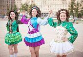 foto of wig  - Three women in irish dance dresses and wig posing outdoor - JPG