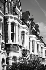 picture of victorian houses  - Black and white monochrome photograph of Victorian terraced town houses in London - JPG