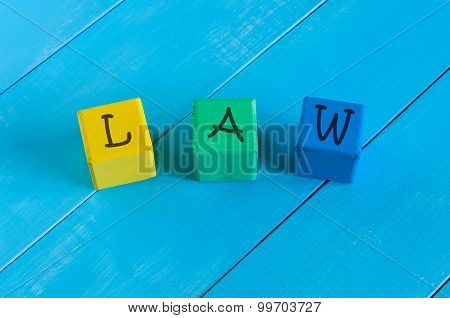 Word Law on children's colourful cubes or blocks