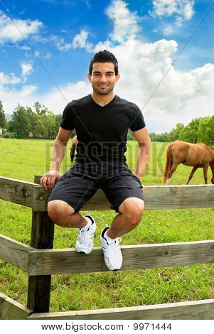 Man Sitting On Fence Countryside