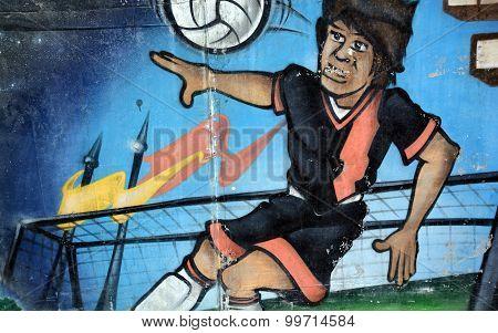 Street art football player
