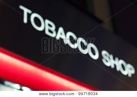 Tobacco shop neon sign - blurred