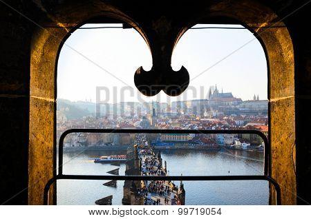 sunset view of Prague castle and Charles bridge over Vltava river, Czech Republic