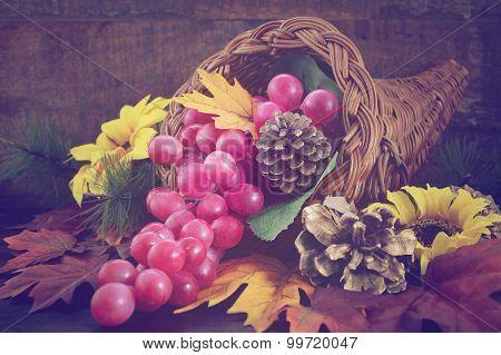Thanksgiving Cornucopia On Wood Background.