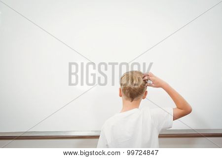 Puzzled student scratching their head at the elementary school