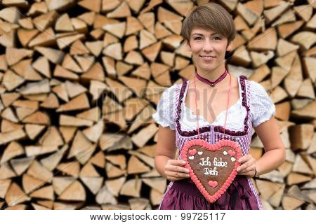 Attractive Young Bavarian Woman Holding A Heart