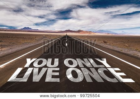 You Only Live Once written on desert road