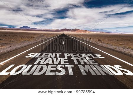 Silent People Have The Loudest Mind written on desert road