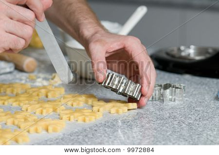 Placing Cookies After Cutting On Backing Paper