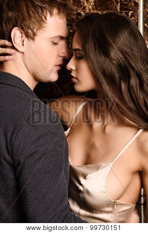 Close-up portrait of a beautiful sexual couple in love. Passion.