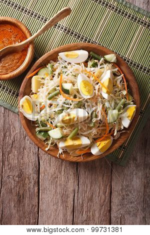 Gado Gado Salad With Peanut Sauce On The Table. Vertical Top View