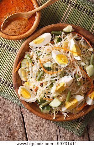 Traditional Indonesian Salad Gado-gado Closeup. Vertical Top View