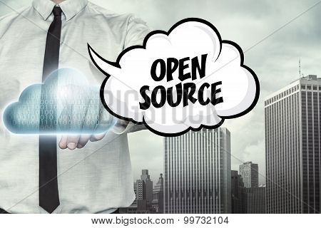 Open source text on cloud computing theme with businessman