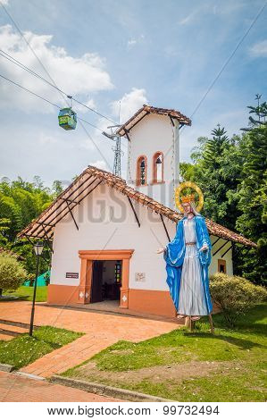 NATIONAL COFFEE PARK, COLOMBIA, Modest white church building inside National Coffee Park with Jesus