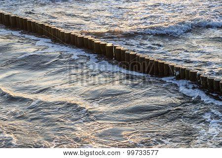 Wave Breakers At The Ocean