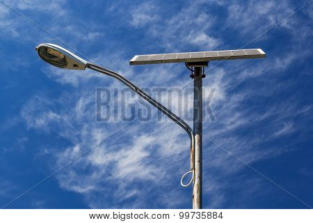 Solar Powered Street Light With Blue Sky And Clouds