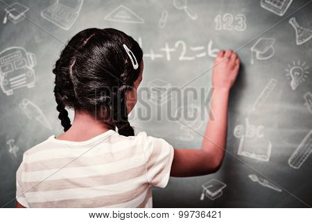 Education doodles against rear view of little girl writing on blackboard