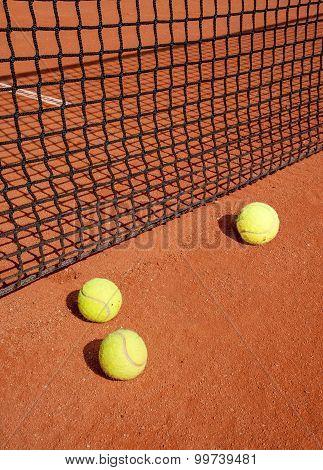 Tennis Balls At The Net