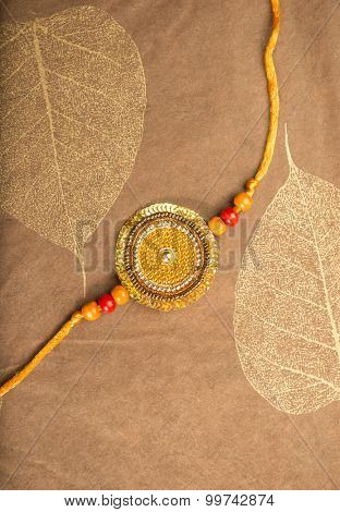 Rakhi or Rakshabandhan- an Indian Traditional Festival. Traditional Rakhi (wrist band) placed on a decorative paper.