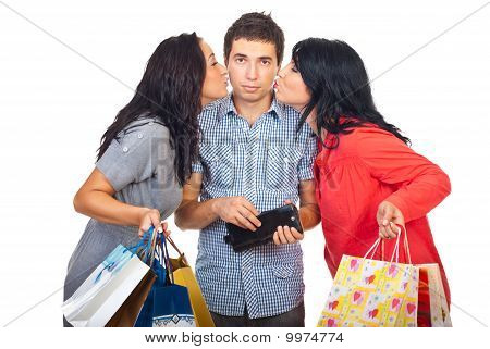 Two Women Kiss Sad Man To Give Them Money