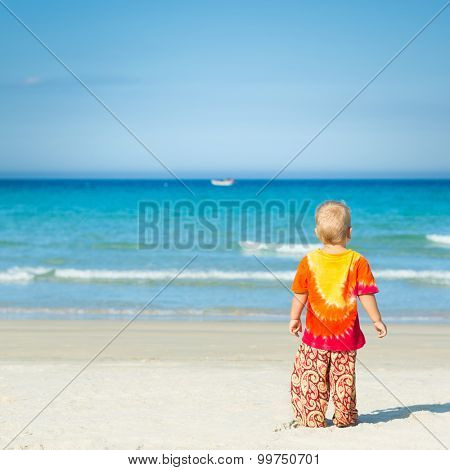 Baby looking sea on the beach