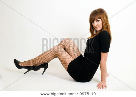 Beautiful red-haired girl with beads
