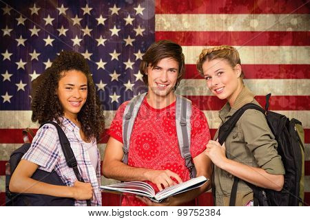 College students reading book in library against usa flag in grunge effect