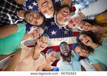 Happy friends in the park against united states of america flag