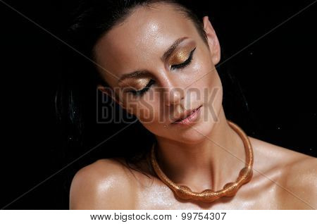 Fashion Portrait Of Shining Glamourous Woman With Wet Skin On Black Background