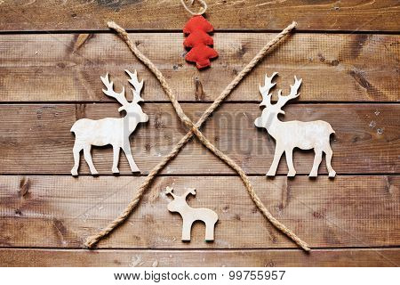 Three wooden xmas deers, toy firtree and two ropes