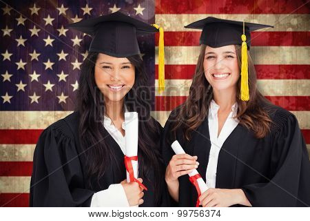 Two friends stand together after graduating against usa flag in grunge effect