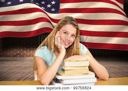 Portrait of female student in library against composite image of digitally generated united states national flag