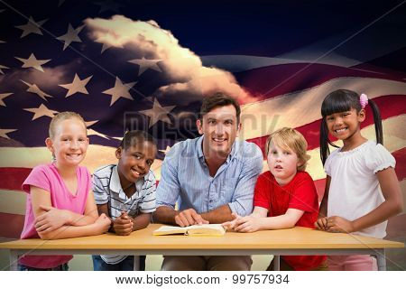 Teacher and pupils smiling at camera at library against composite image of digitally generated american flag rippling