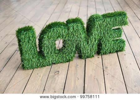 word Love on wooden background