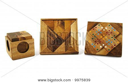 Three Wooden Puzzles Isolated