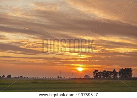 Lower Saxony bog landscape at sunset, wind turbines at horizon