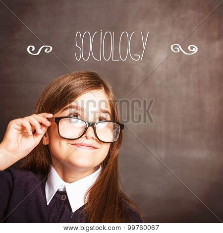 The word sociology against cute pupil smiling and looking up
