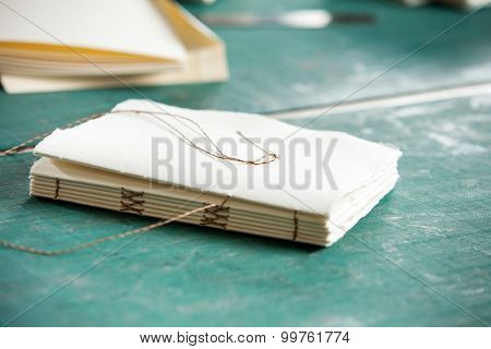 Closeup of thread and papers on table in factory