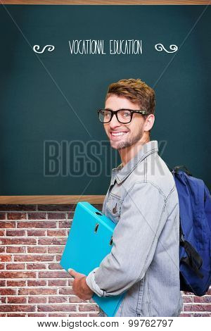 The word vocational education and student smiling at camera in library against teal, blue
