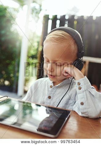 Smiling Little Boy Listening Quietly To His Music