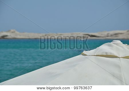 Beach Parasol With Sea, Sky And Cay