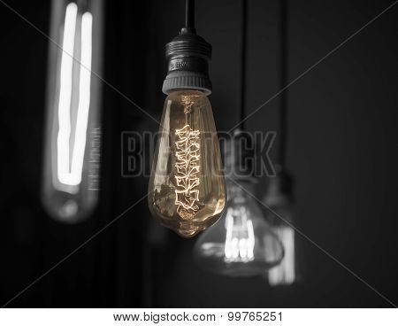 Hanged Light Bulbs In Dark Room Color-splash Tone