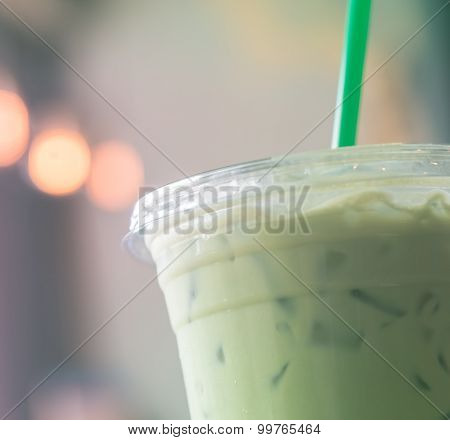 Plastic Cup Of Iced Matcha  With Green Straw In Like Instagram Filter