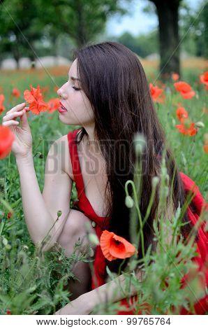 Girl Smells Flower