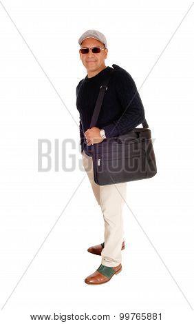 A Hispanic Man His Laptop In A Bag.