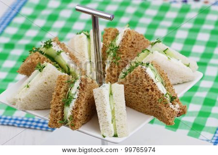 Cream cheese and cucumber sandwiches on checkered cloth