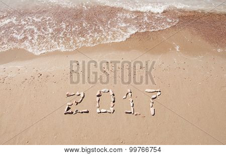 2017 written on sand beach at ocean